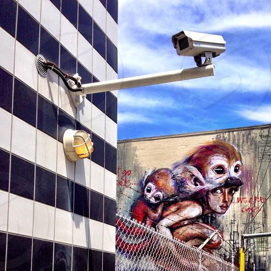 Striped wall mural surveillance camera photo