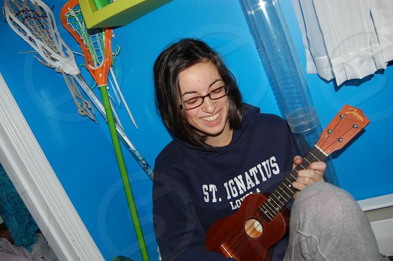 girl laughing with ukelele  photo