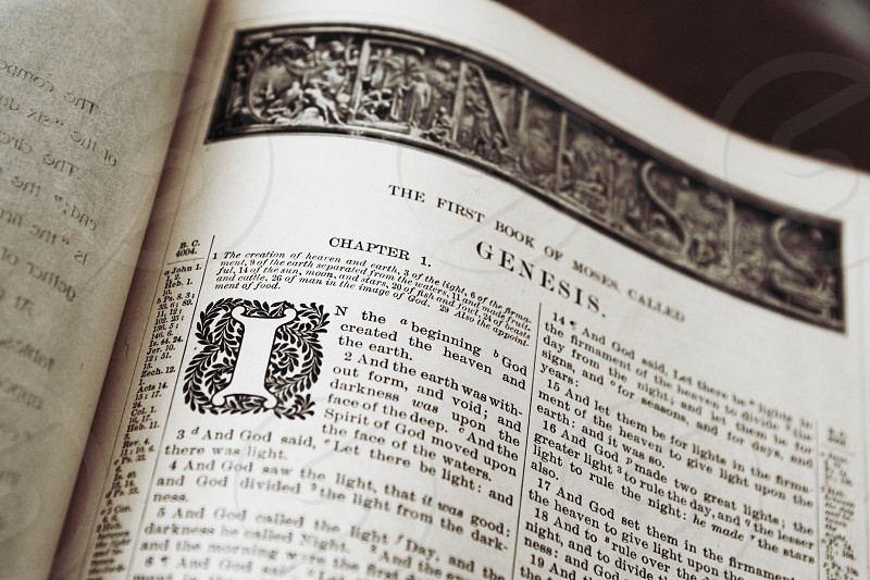 Old bible opened to the book of Genesis photo