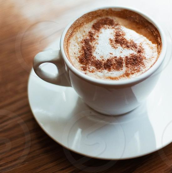white ceramic mug with heart latte art photo