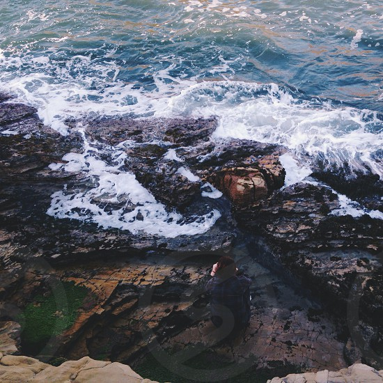 rock formation on sea side photo