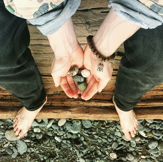 stone picking with my love at the beach photo