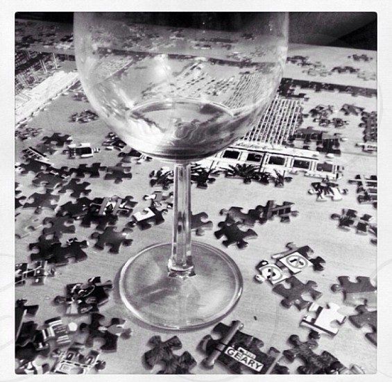 wine glass on jig saw puzzle pieces photo