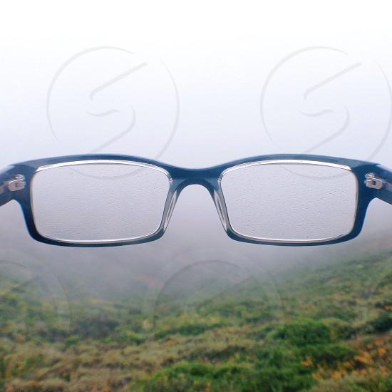 black and clear framed eyeglasses photo