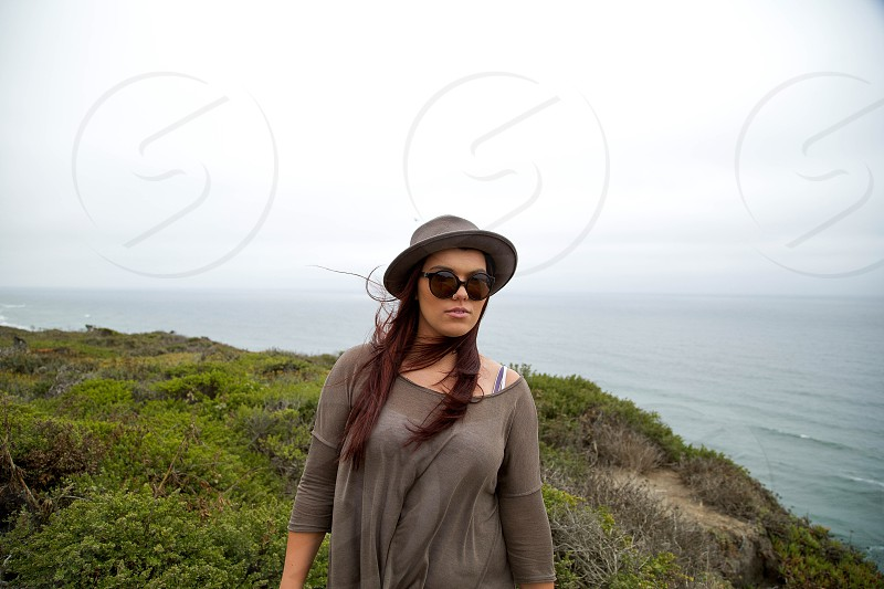 woman in gray long sleeved shirt and gray hat photo
