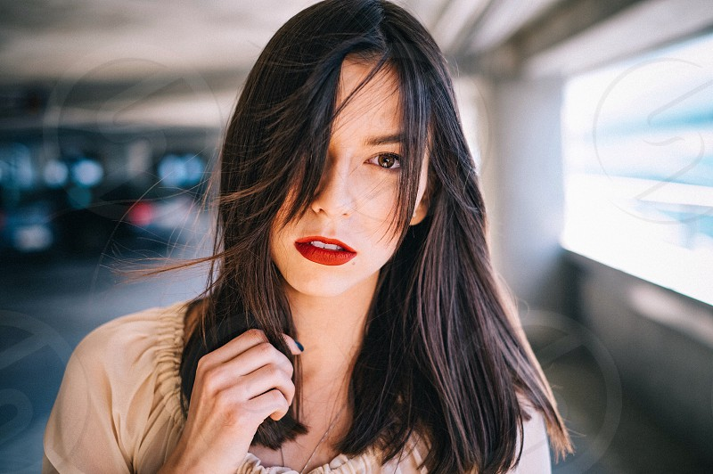 Woman with red lips looking at camera photo