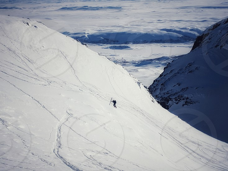 Skier walking up the hill in Norway photo