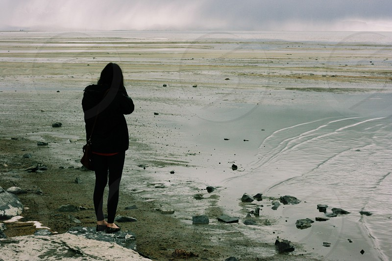woman standing on sea side  photo
