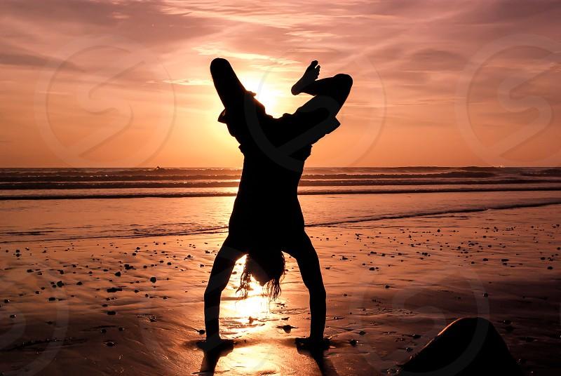 person on beach silhouette  photo