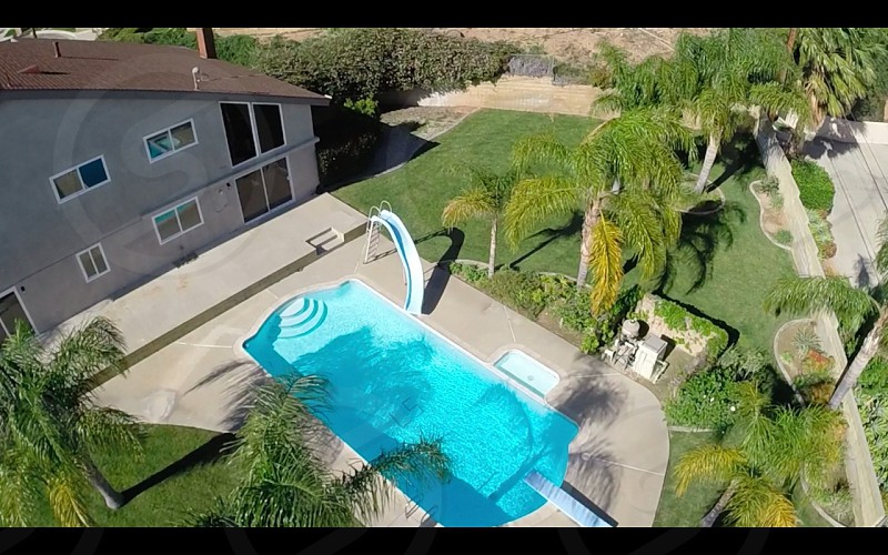 Aerial of the backyard of a home in CA. photo