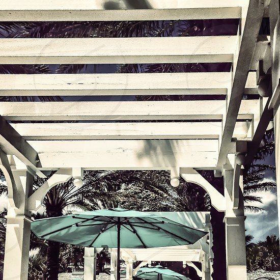 white wooden patio roof green umbrella photo