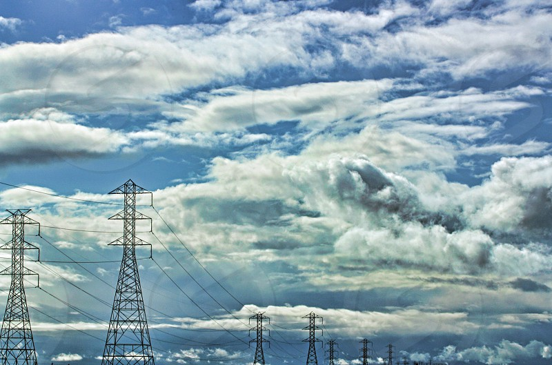 Power transmission lines against a cloudy sky photo