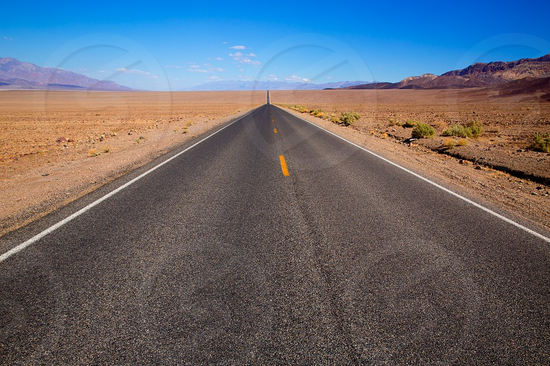 Badwater road Death Valley straight in desert to mountains National Park California photo