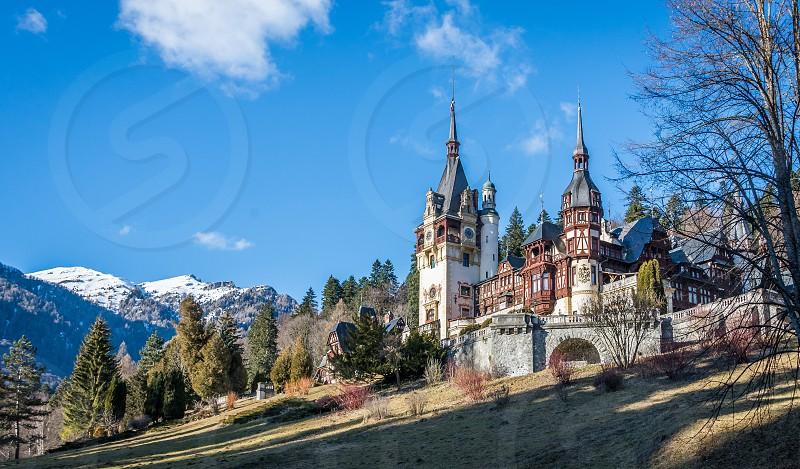 Peleș Castle near Sinaia and the Carpathian Mountains in a sunny day. Transylvania Romania photo