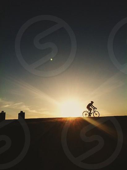 man biking silhouette photo