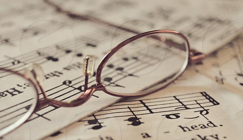 eyeglasses on musical sheet photo
