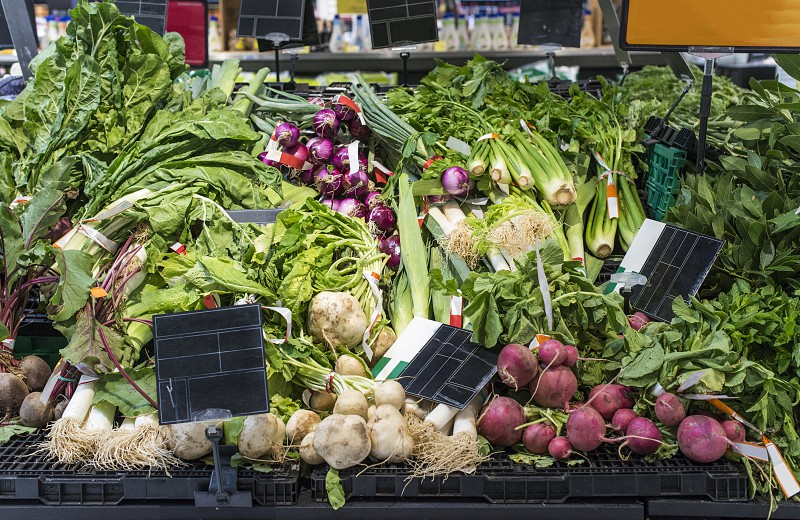 Roots vegetables on stand in supermarket photo