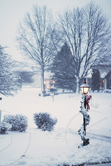 black street lamp and white snow photo
