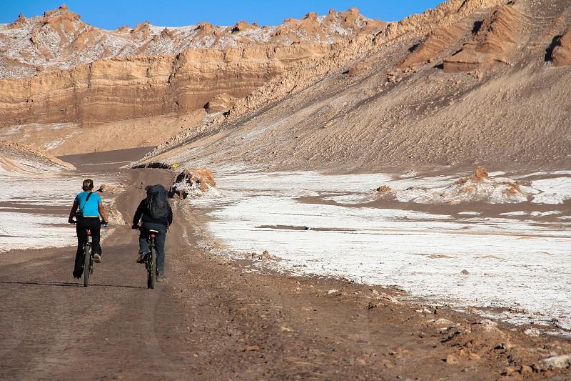 Bicycling through the Valley of the Moon in the Atacama Desert near San Pedro de Atacama Chile. photo