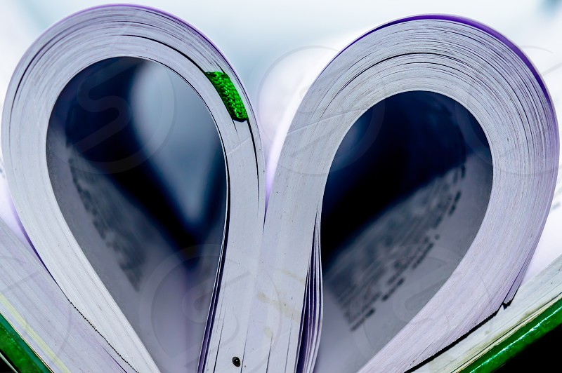 Close up heart shape from paper book with blur background. Heart book page - vintage effect style pictures. Concept for valentine's day. photo