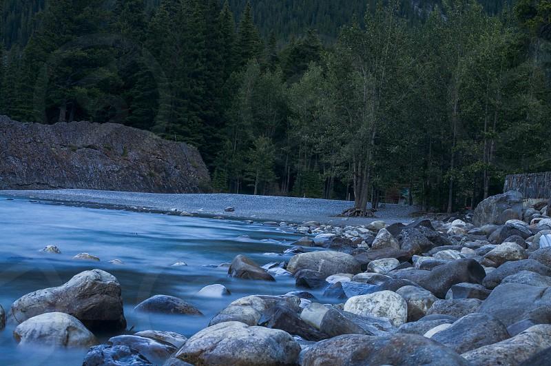 fresh water stones near to body of water photo