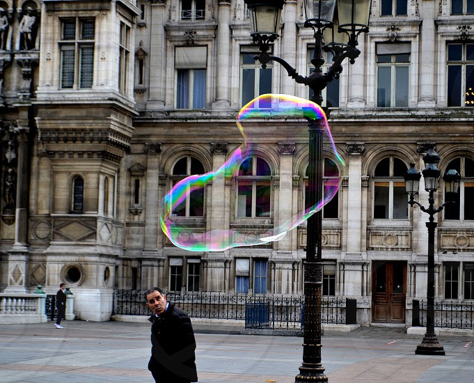 The Curious Case of the Man and the Bubble. Paris France 2012 photo