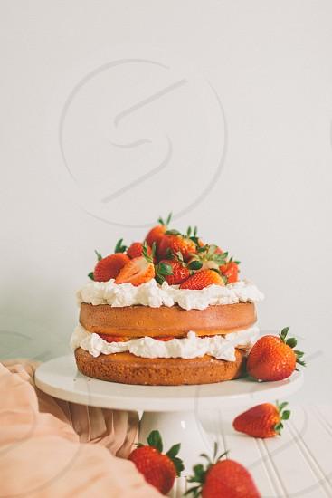 A styled photo of a strawberry shortcake. photo