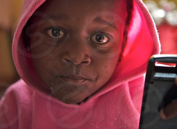 Sadness child pink eyes Africa photo