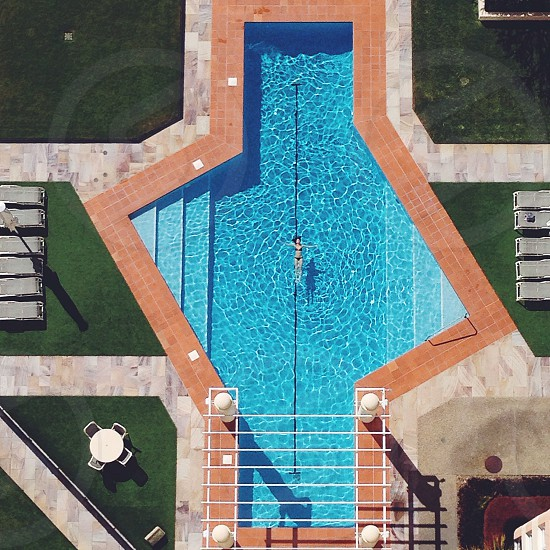 Summer memories swimming in the pool - captured from above in a high-rise hotel. photo