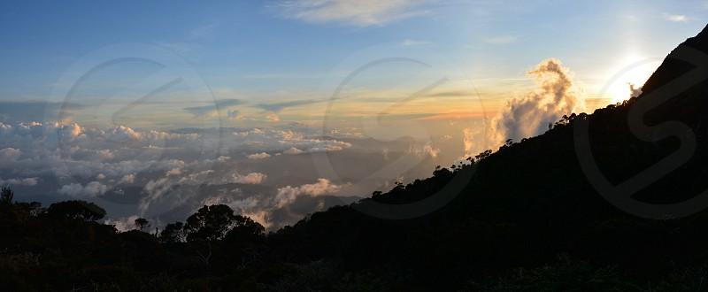 Sunset on the slopes of Mt Kinabalu Sabah Borneo photo