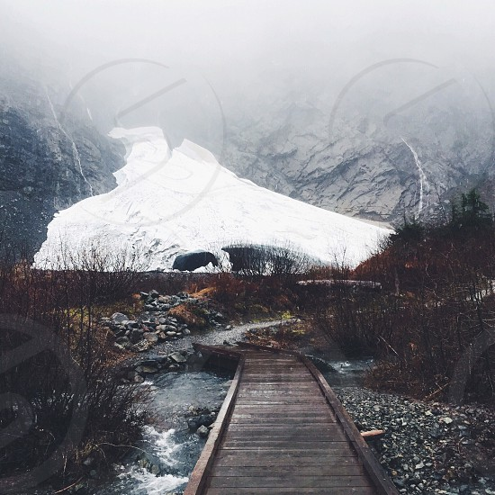 white mountain slope at the of railroad track photo