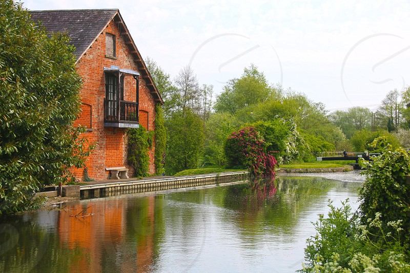 riverside view of brown house photo