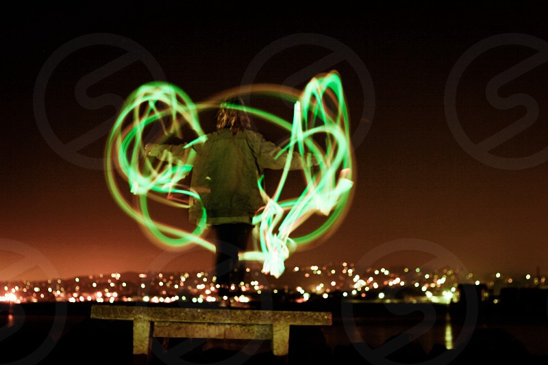light painting photography of person wearing green jacket photo