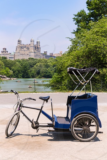 Central Park Manhattan The Lake rickshaw bike New York US photo