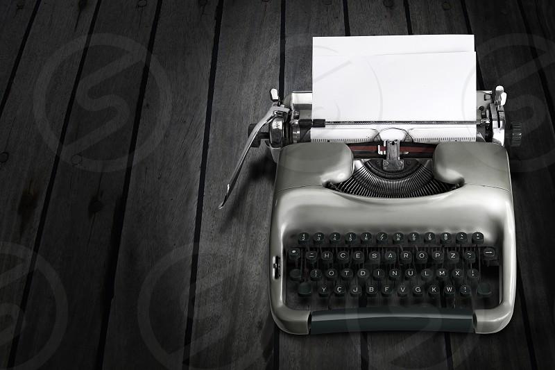 Antique; Brown; columnist; Ernest Hemingway; Journalist; Letter; novelist; Old; Old-fashioned; Paper; Playwright; Printout; short-story; Storytelling; Typewriter; Typing; Writing; typewriter; typing; type; typescript; writer«s block; writers block; concept; conceptual; trash; inspiration; novel; story; stories; journalism; bestseller; antique; old; vintage; old fashioned photo