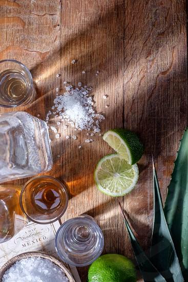 Tequilalimeagave leafMexicomapdrinksaltbottlespiritsalcoholshot glassfood and drinkcover shotAnejoReposedblanco photo