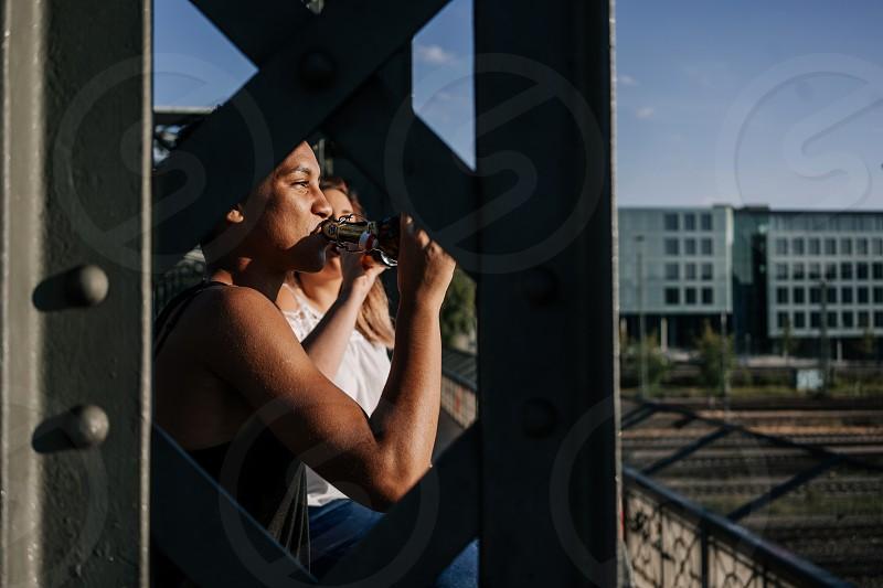 Two friends having a beer on a Munich bridge photo