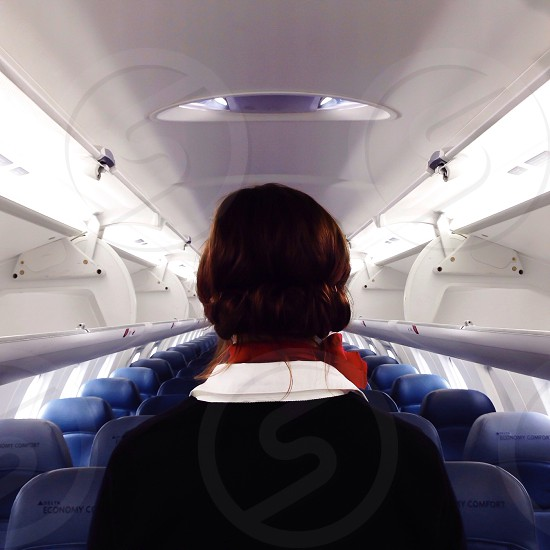 flight stewardess inside the plane photo