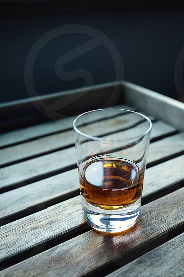 clear shot glass with brown wine photo