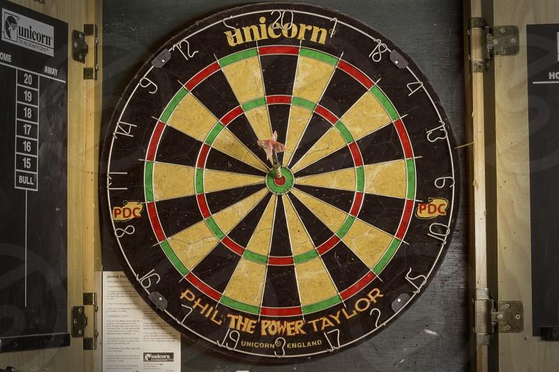 black and yellow unicorn dart board photo