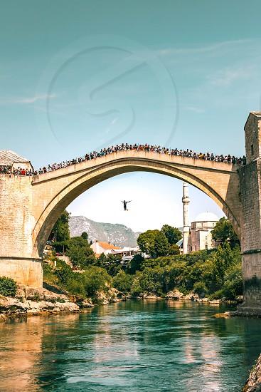 Bridge diver in Mostar Bosnia photo