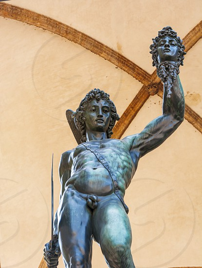 the bronze statue of Perseus holding the severed head of Medusa made by Benvenuto Cellini in Florence Italy photo