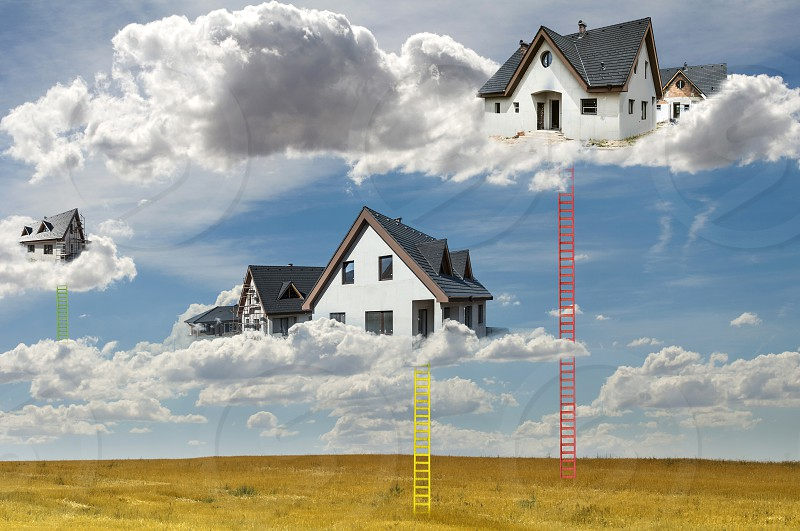 Houses on the clouds and ladders. Abstract concept for smart houses and cloud networks. New build houses. photo