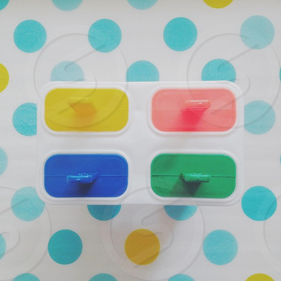 pink green blue and yellow plastic lid photo