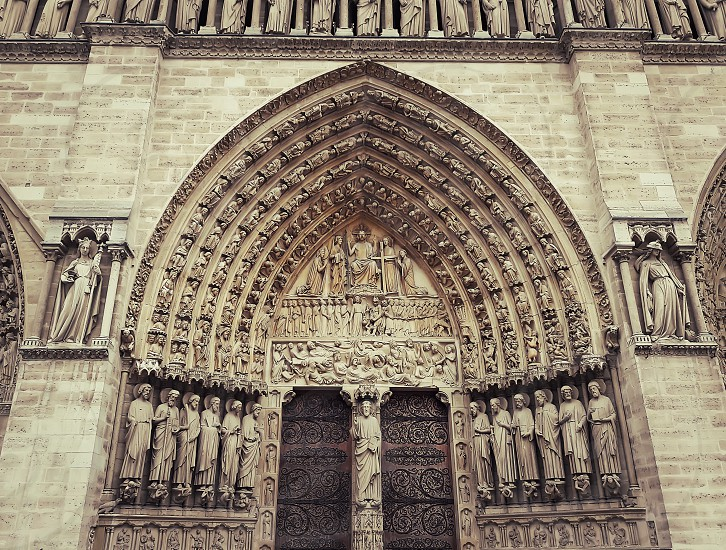 Sculpted tympanum of the Last Judgment over the entrance of the Notre-Dame de Paris. photo