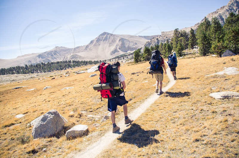 hiker hiking backpacking mountains california active lifestyle fitness outdoors mountaineering photo