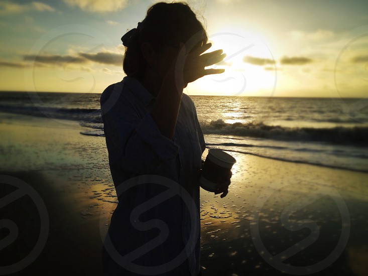 person on beach holding bag photo