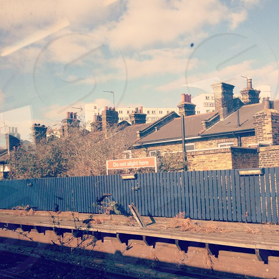 An urban London scene taken from a train of a disused train station. View of the platform. photo