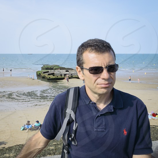 Man with the sea as background. photo