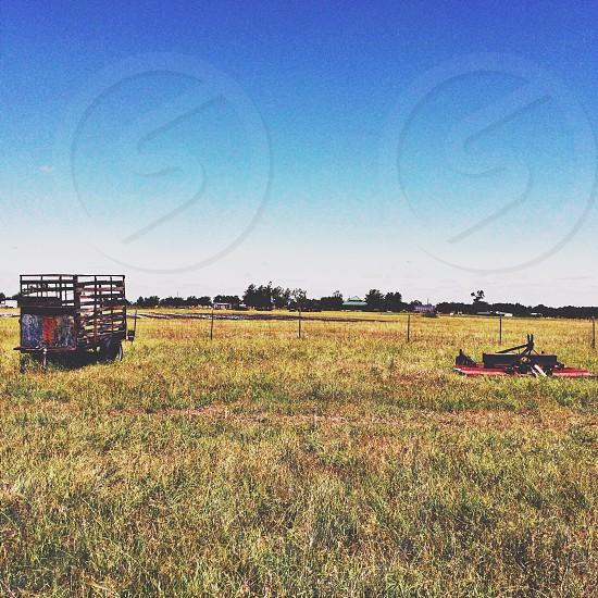 Wide open farm land in Texas near dallas. Old farm equipment on property.  photo